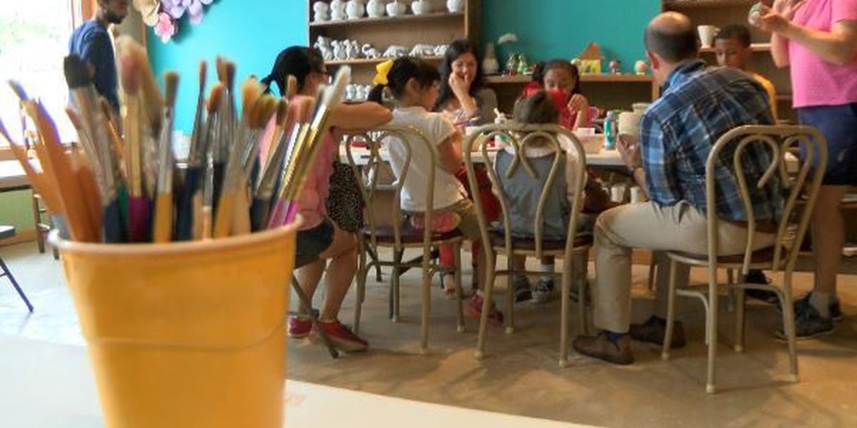 Children paint pottery to raise money for food pantry