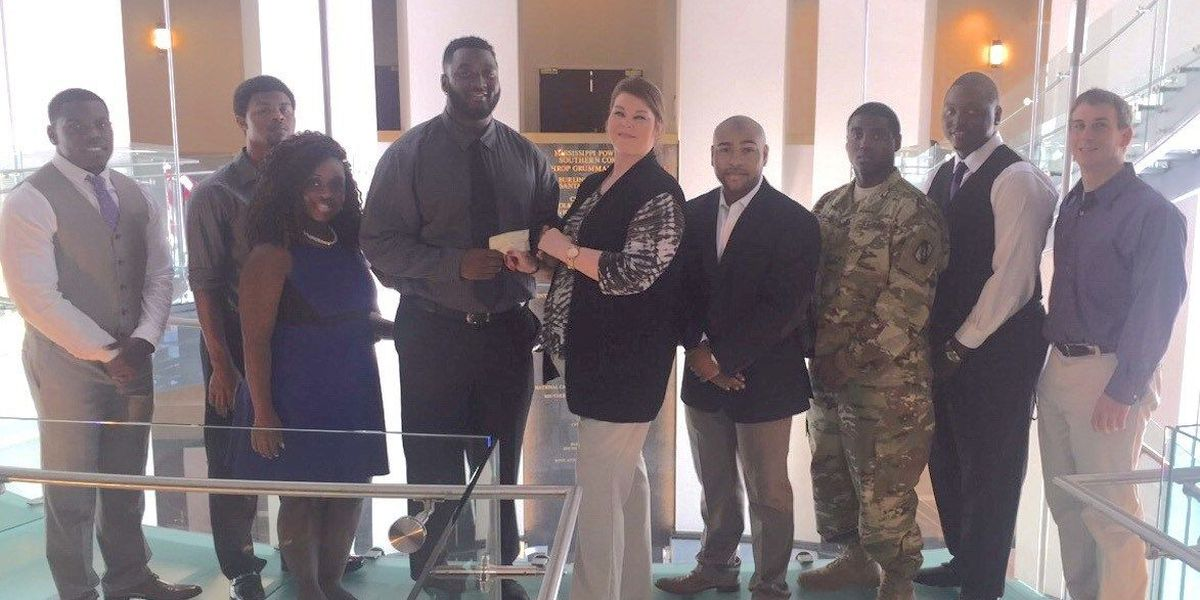 Fraternity presents large check to USM Foundation
