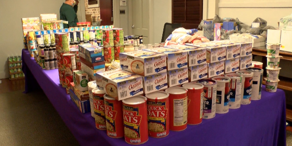Law firm packs food boxes for Extra Table