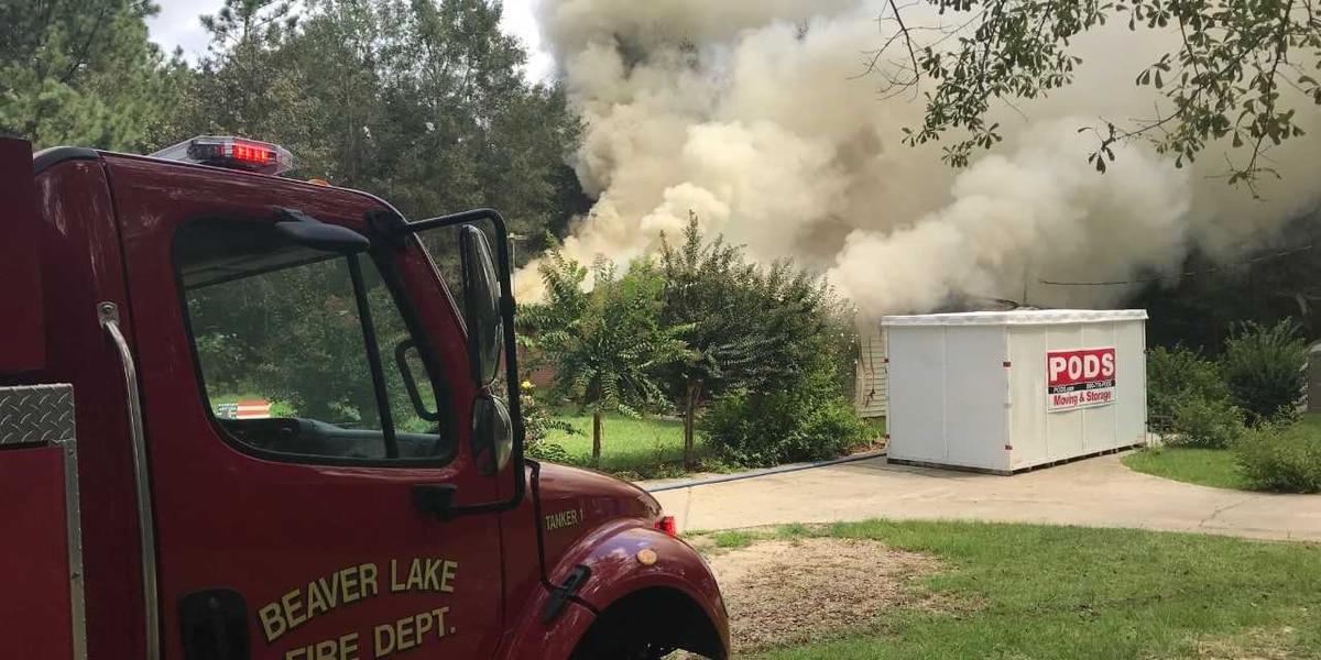 Firefighters battle Purvis house fire