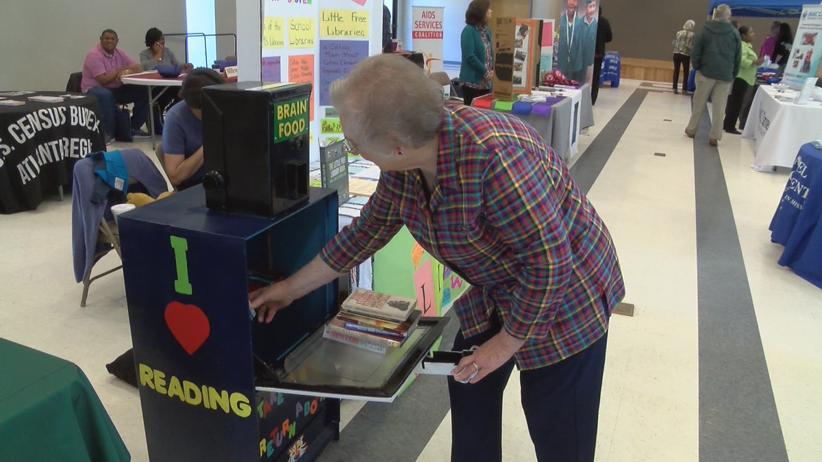 Old newspaper machines distributing free books in Covington County