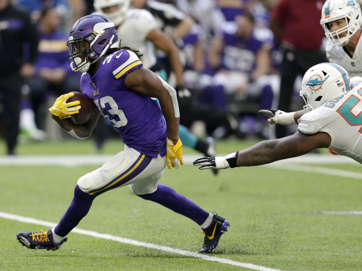 Cook carries Vikings past Dolphins 41-17