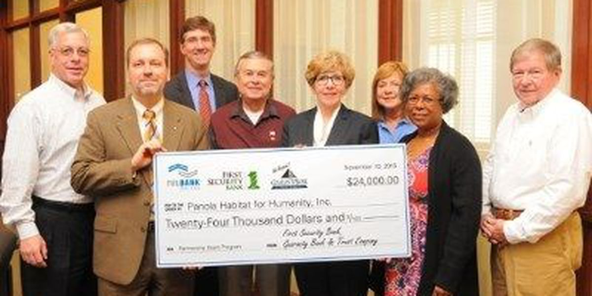 Banks join together to donate $24k to Panola Habitat for Humanity
