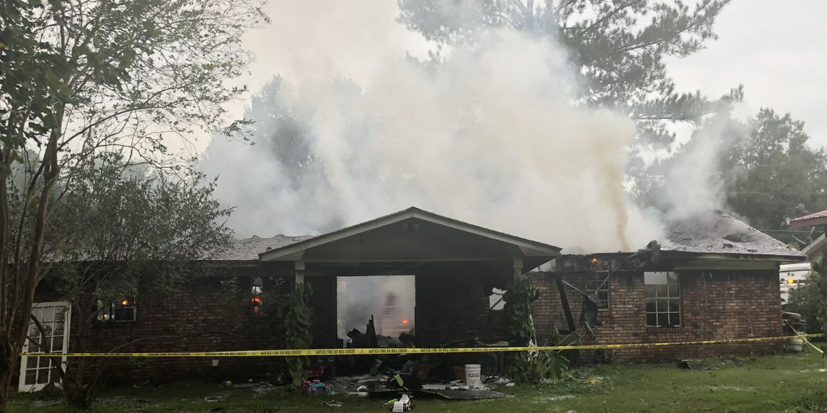 PHOTOS: Ellisville house fire investigated as possible arson