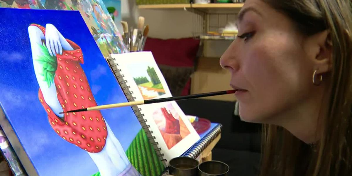 Artist paralyzed by gunshot paints with her mouth