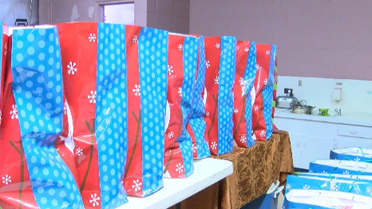 Toys for Tot's volunteers fill bags for pine belt children