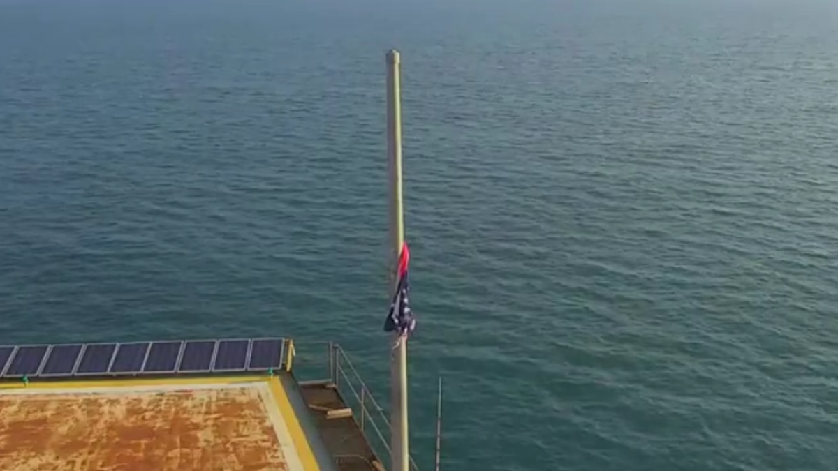 LIVE: American flag at Frying Pan Tower survives storm