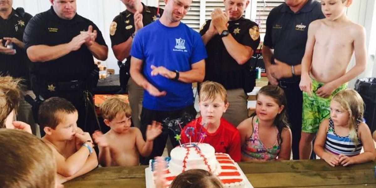 Oak Grove child gives birthday wish to fallen officer's children