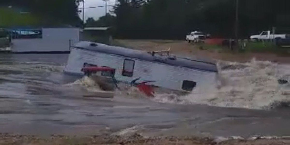 VIDEO: Flash Flooding sends camper floating down Peps Point Road