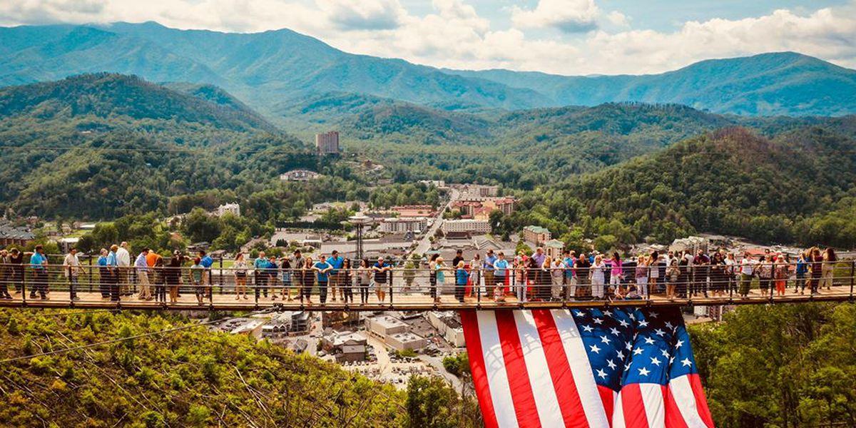Giant American flag draped over North America's longest pedestrian suspension bridge