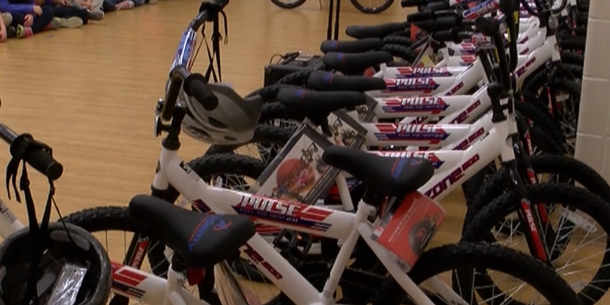 Students surprised with bikes and helmets for good behavior