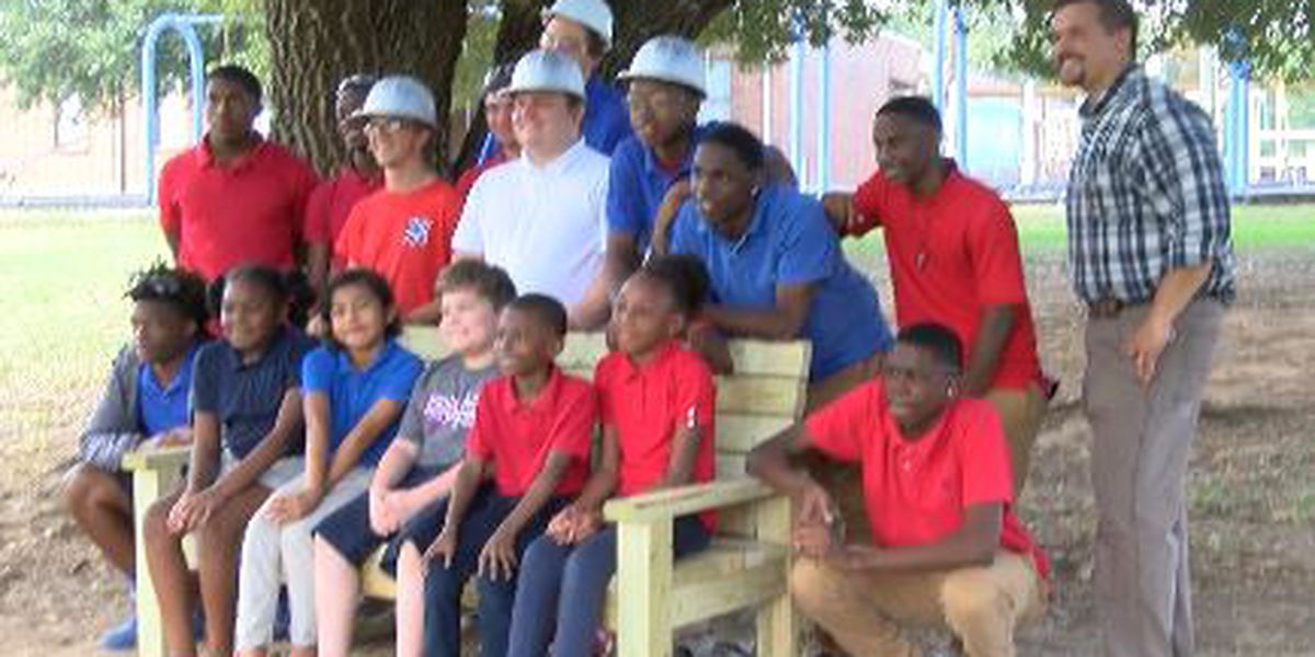 North Forrest High School students building friendships by building benches