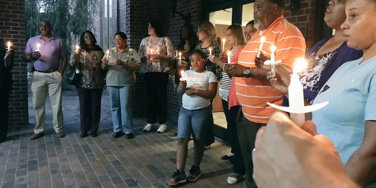HPD hosts candlelight vigil for victims of domestic violence