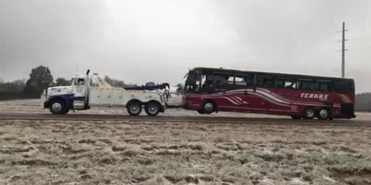 Tour bus hauled away after deadly crash