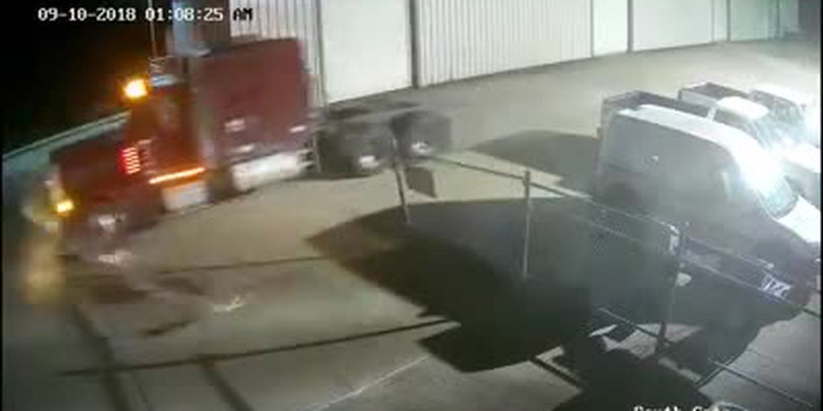 WATCH: Thief steals semi-trailer truck from dealership, crashes through gate