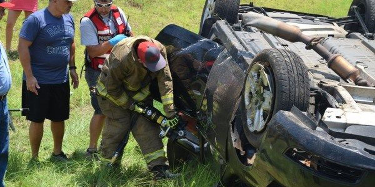 Woman injured, trapped in roll over accident