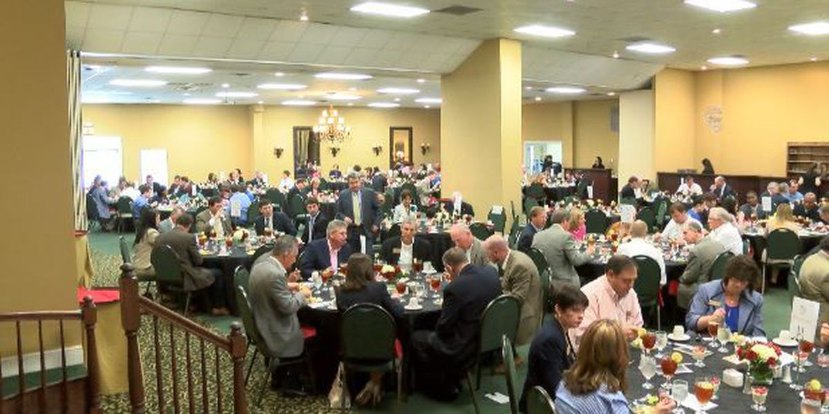 William Carey holds business luncheon