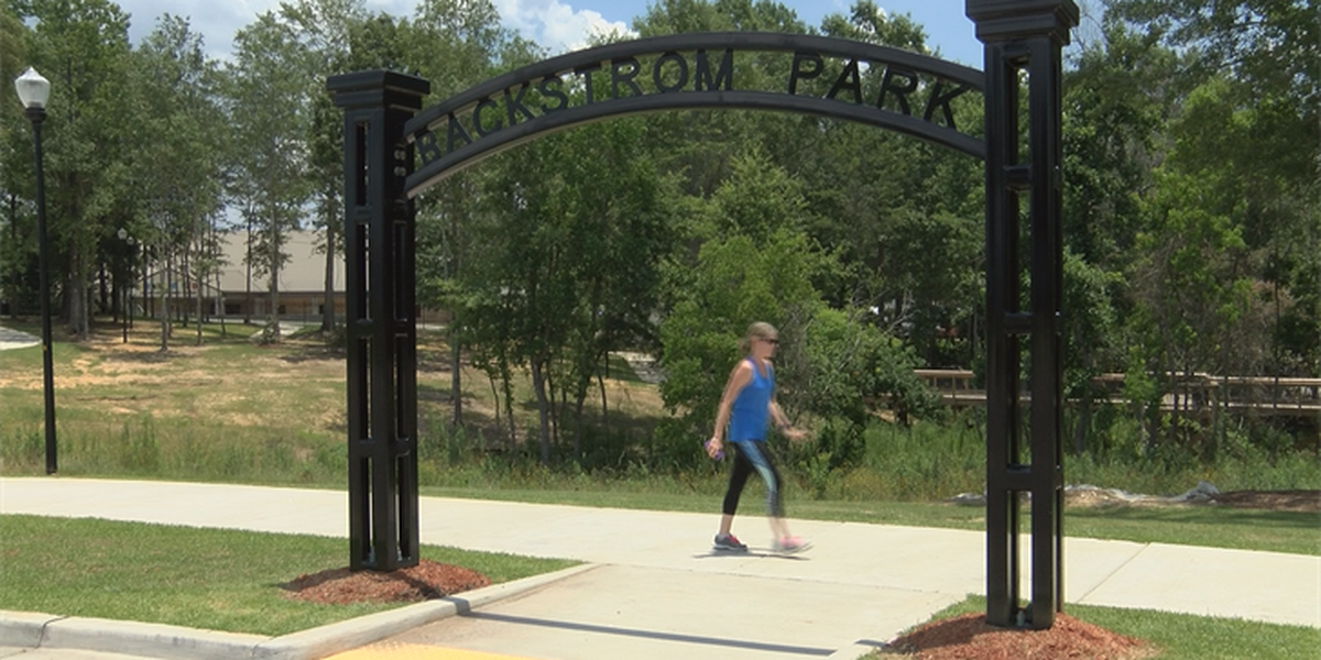 Ribbon cutting held for new walking trail at Optimist Park