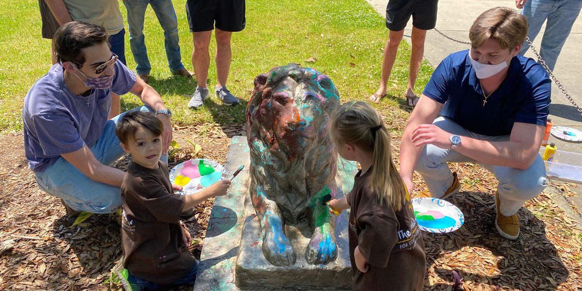 USM Children's Center, SAE partner to paint lion statue