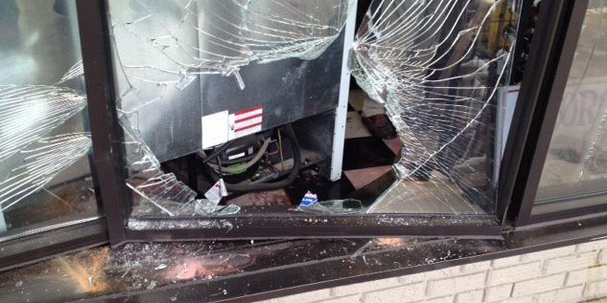 Man drives truck through front of liquor store in Laurel