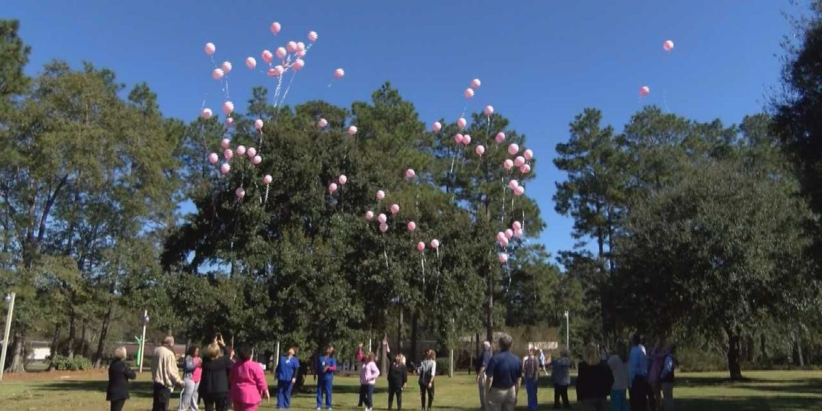 Merit Health Wesley holds balloon release to remember victims of breast cancer