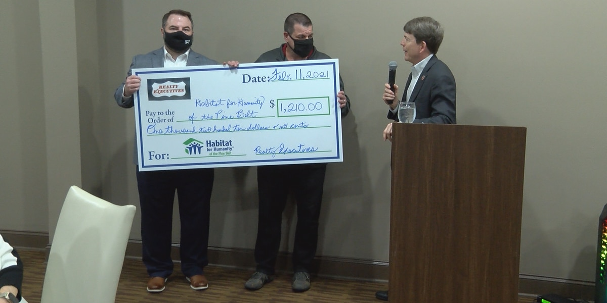 Realty Executives makes annual donation to Habitat for Humanity