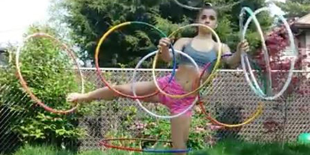 VIDEO: Girl simultaneously spins 9 hula hoops