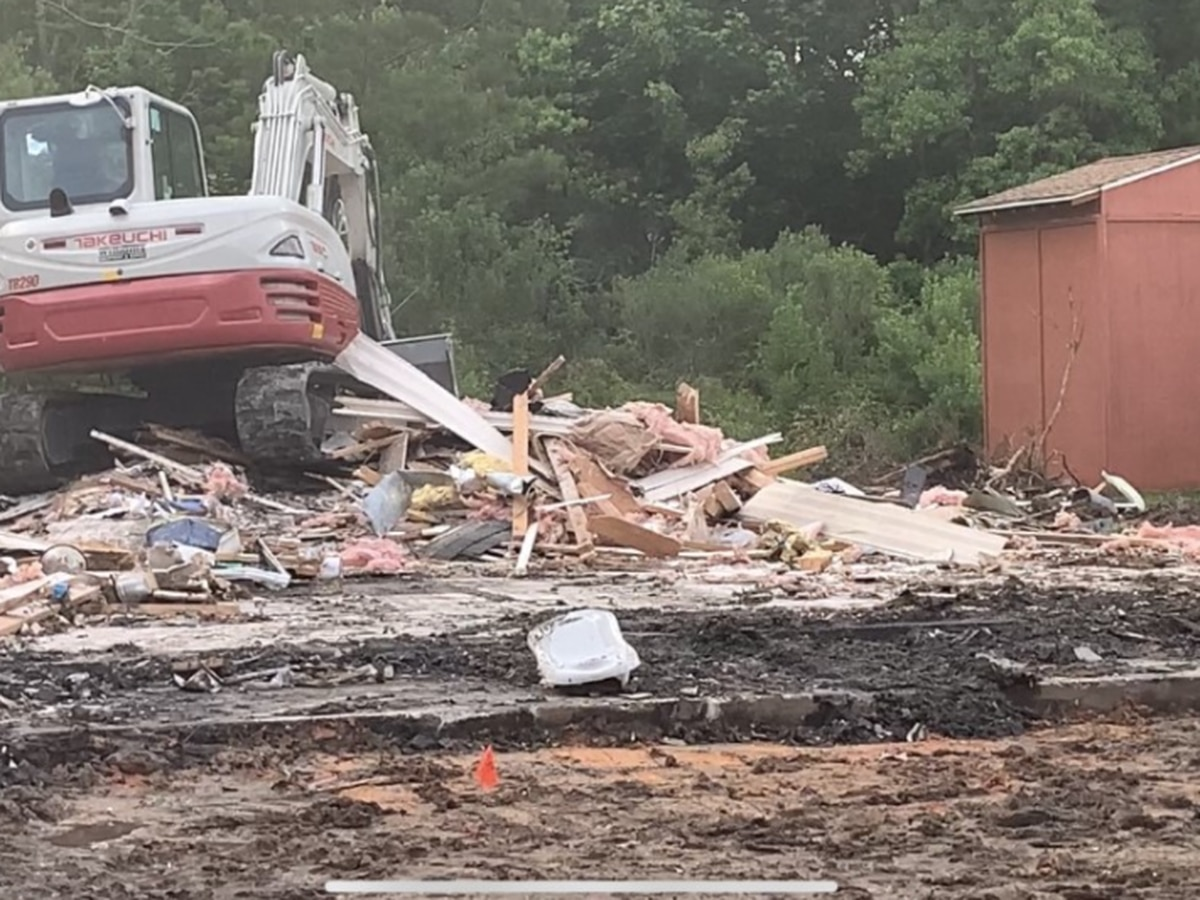 NTSB removes plane crash debris for examination, home torn down