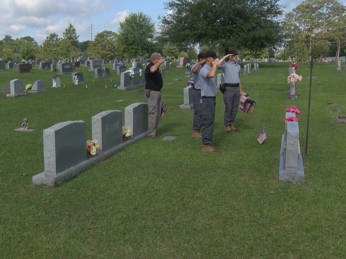 Volunteers place American flags on Hattiesburg veterans' graves