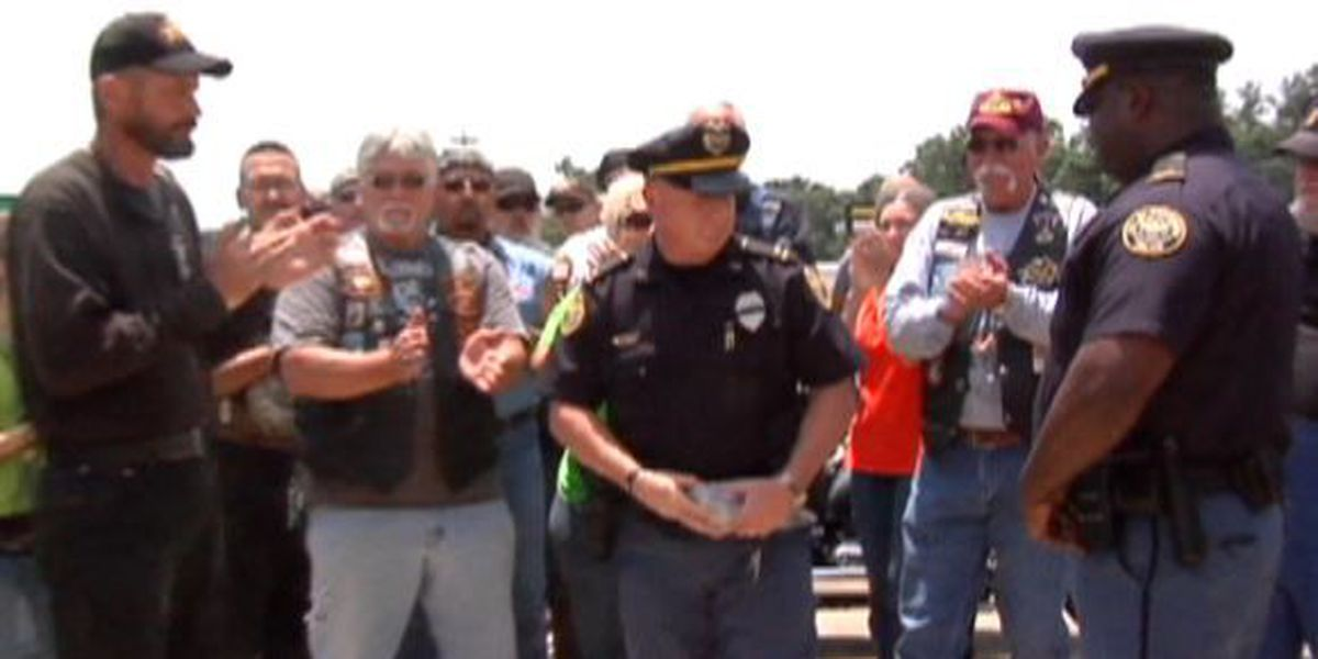 Escorts from Trail of honor make donation to Hattiesburg Police