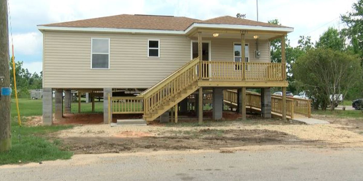 Community hosts home dedication for two tornado victims