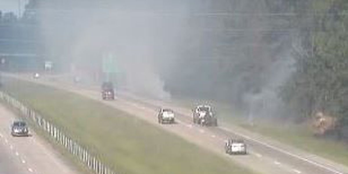 Grass fire on interstate near Evelyn Gandy exit