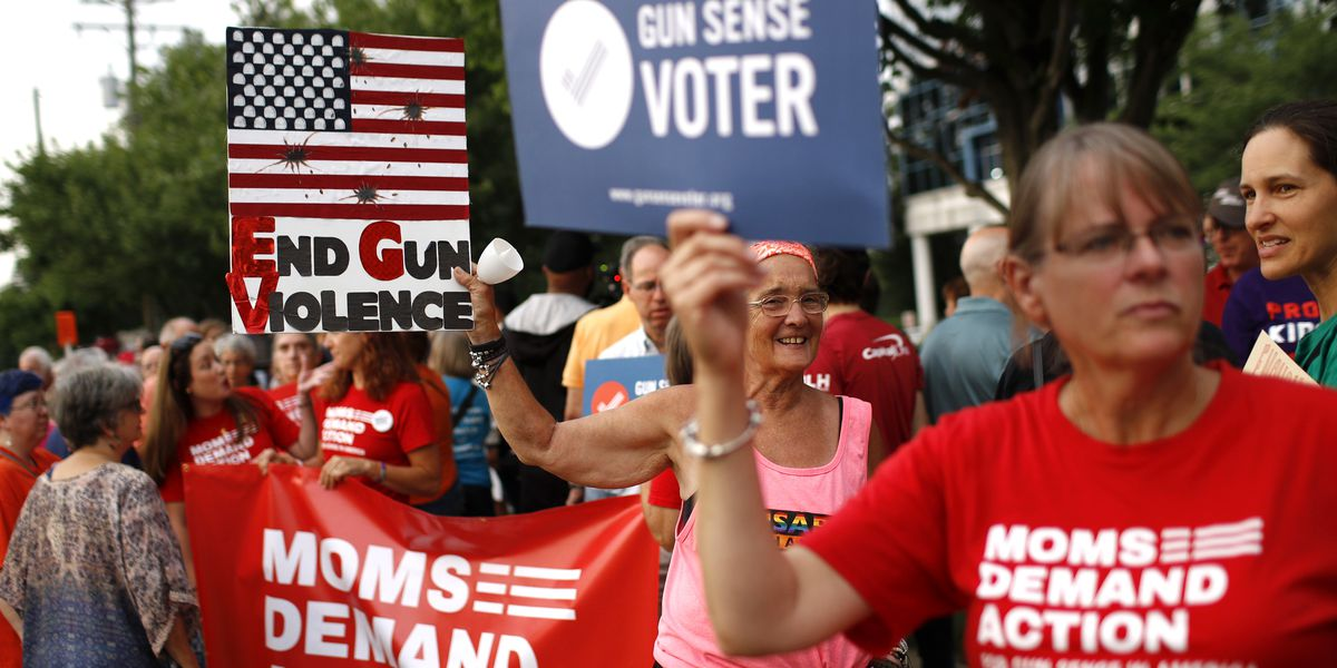 Hundreds hold vigil at NRA headquarters for shooting victims