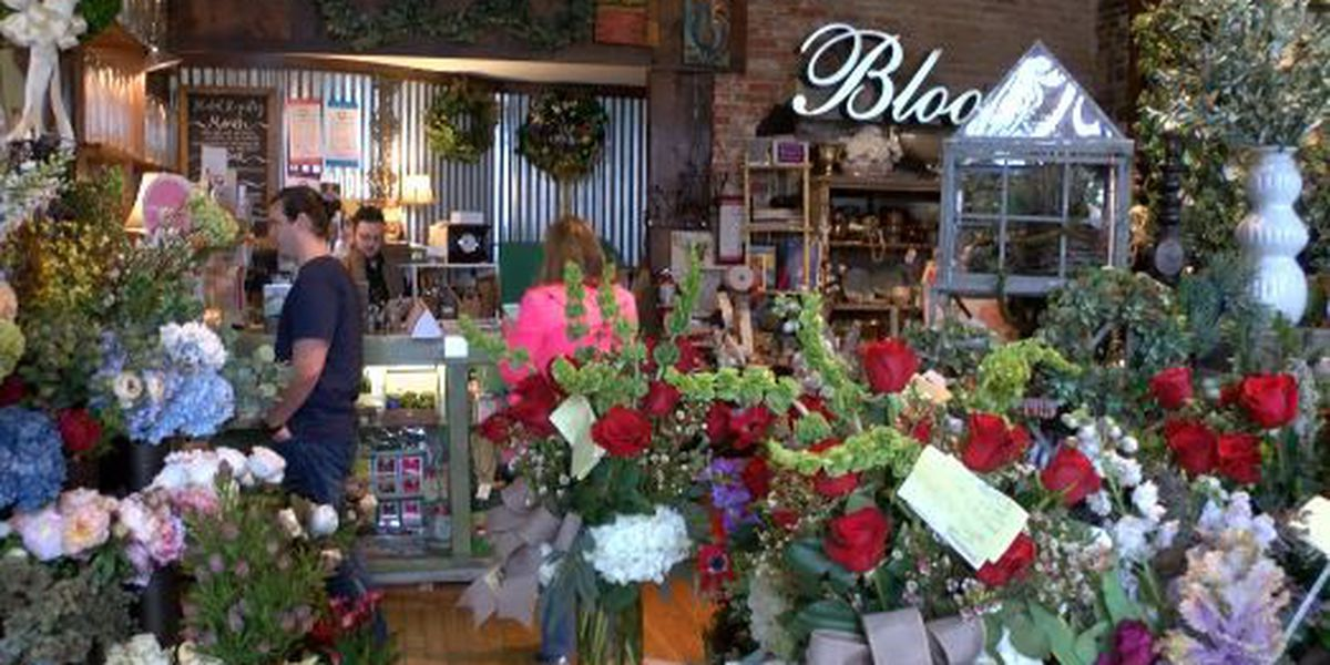 People surprised with flowers on Valentine's Day