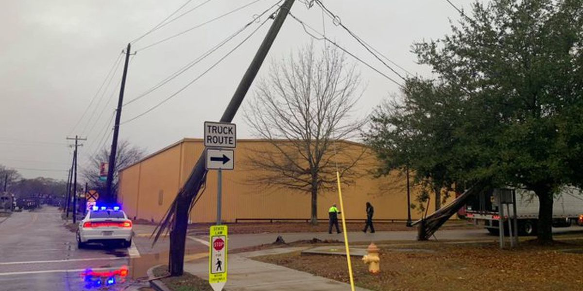 Traffic lights out downtown after 18-wheeler hit several power poles