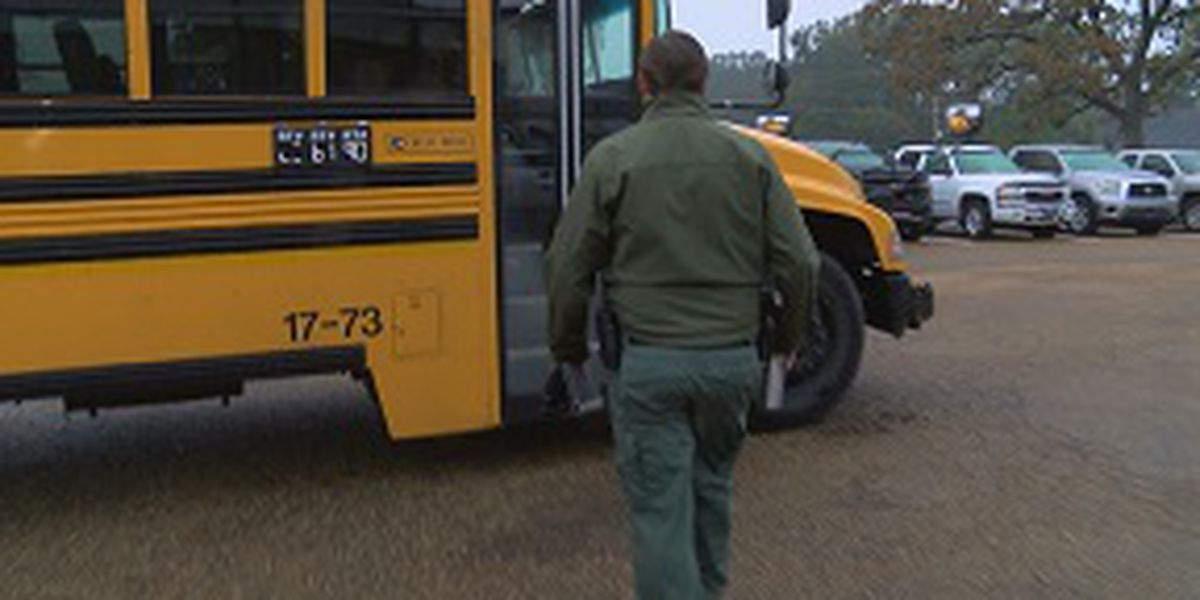 Clinton police officers ride along on city school buses