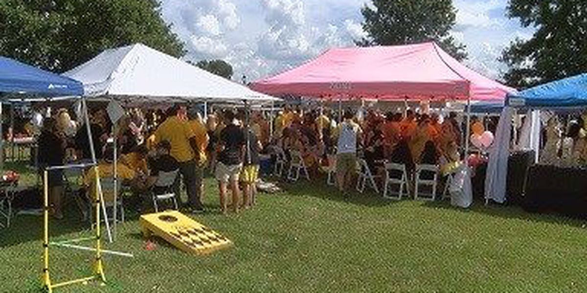 Tailgaters enjoy holiday at The Rock to show senior players support
