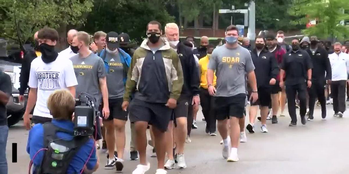 USM football players skip practice, march against social injustice