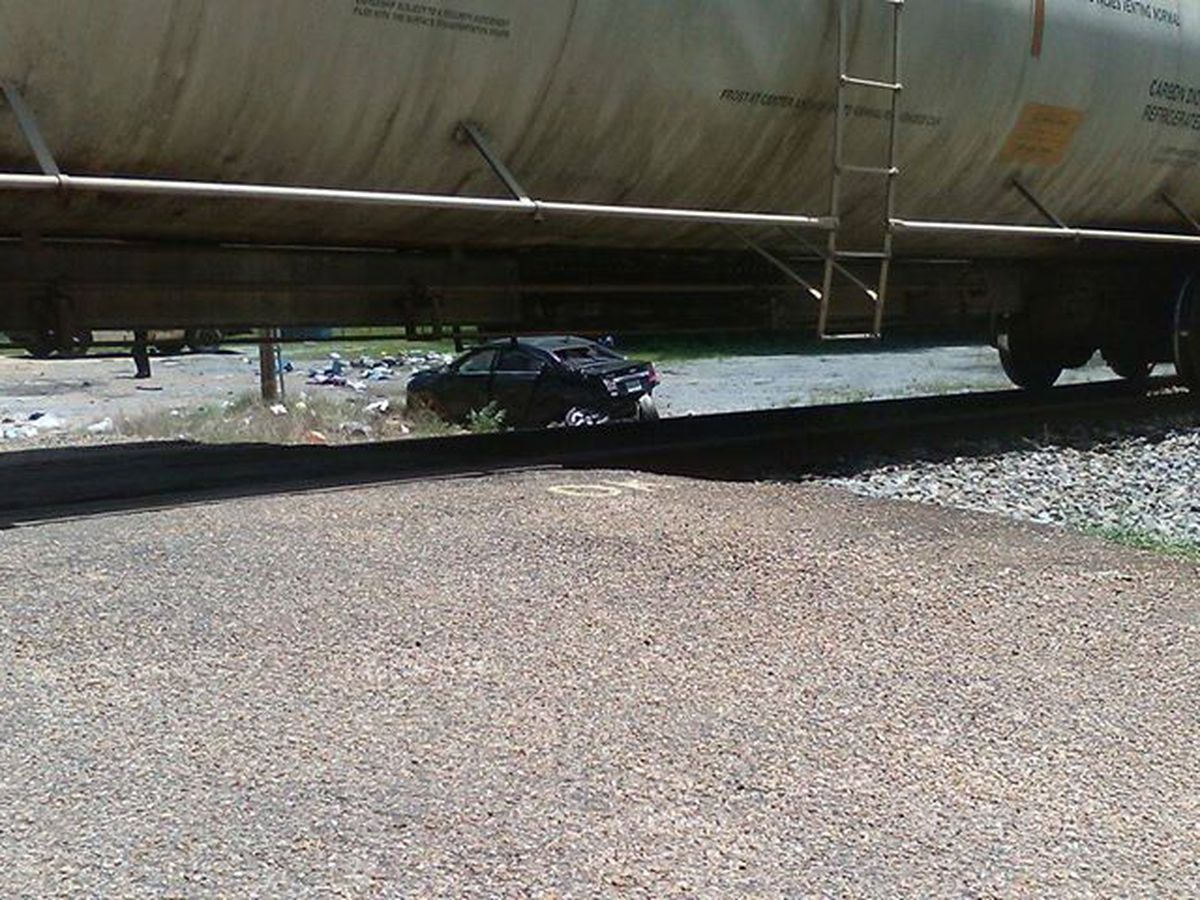 Driver suffers only minor injuries in crash with train