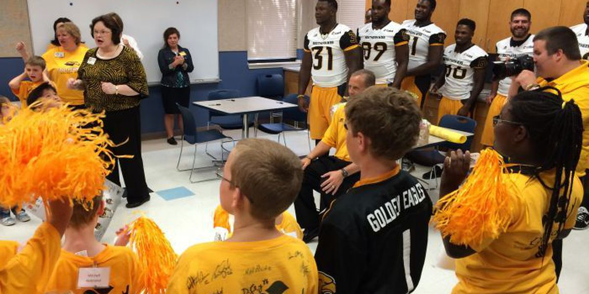 Golden Eagle football makes annual pre-game visit to Dubard School