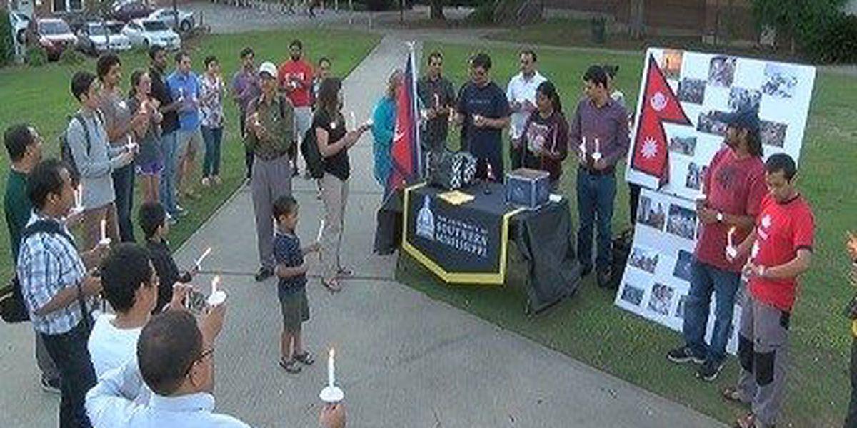 USM students host candlelight vigil for Nepal quake victims