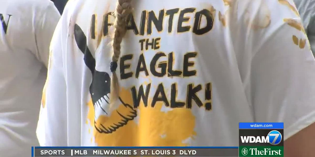 USM students participate in tradition of painting Eagle Walk