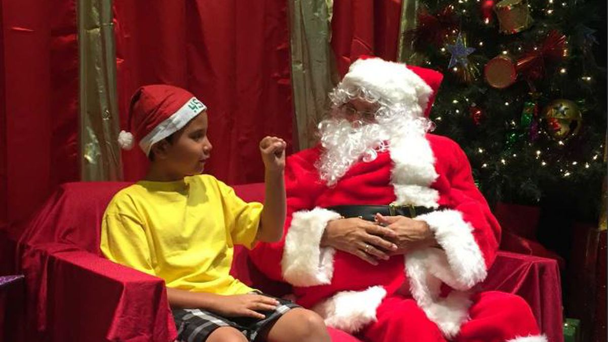 Deaf Santa gives children a chance to say what they want for Christmas in American Sign Language
