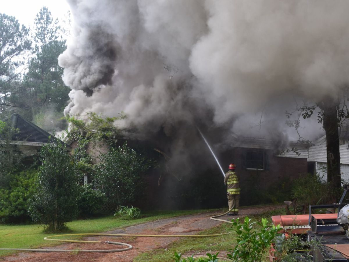 Crews battle house fire in Jones County