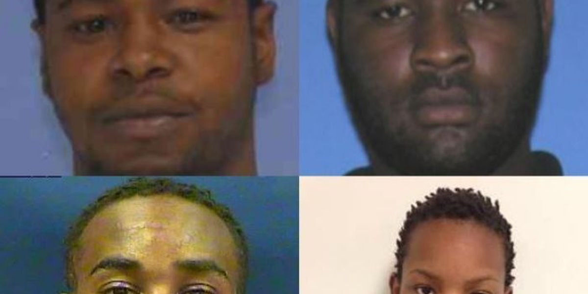 Four suspects in officer shooting make initial appearance