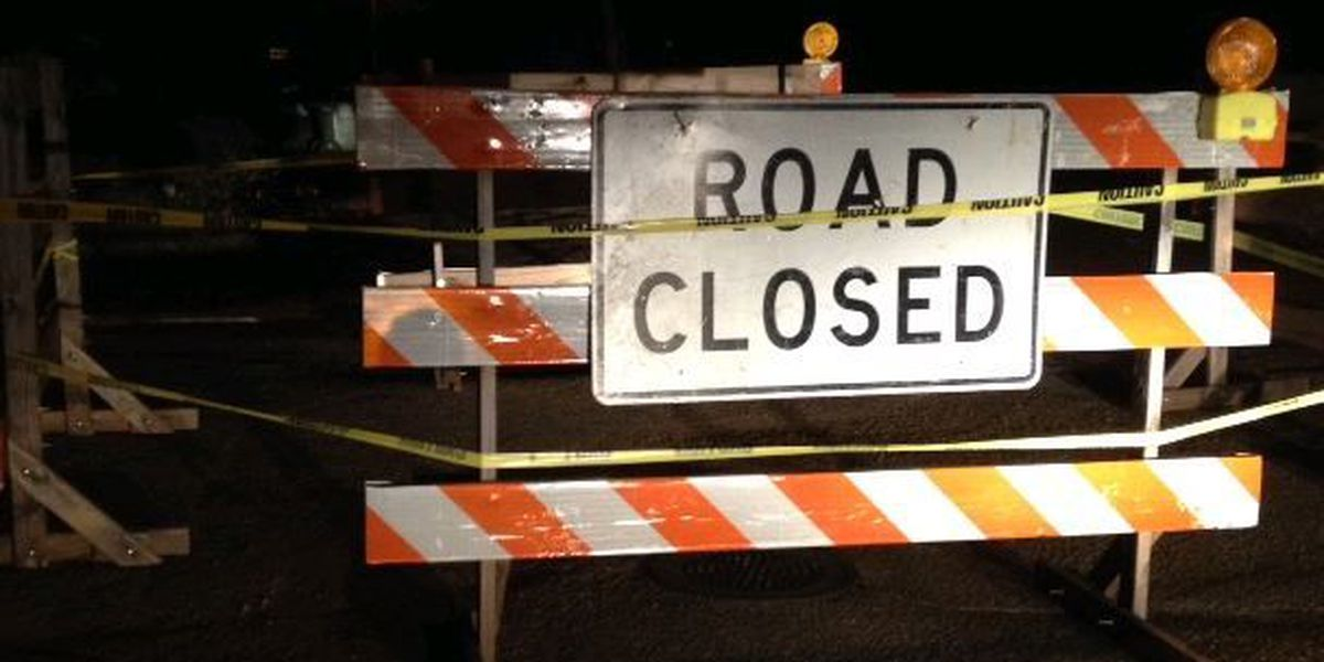 Gaping hole causes road closure