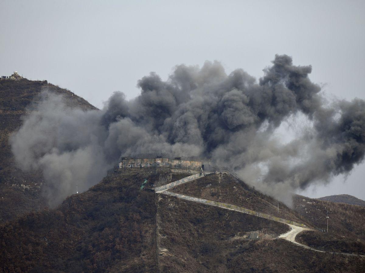 South Korea dismantles guard posts with dynamite, excavators