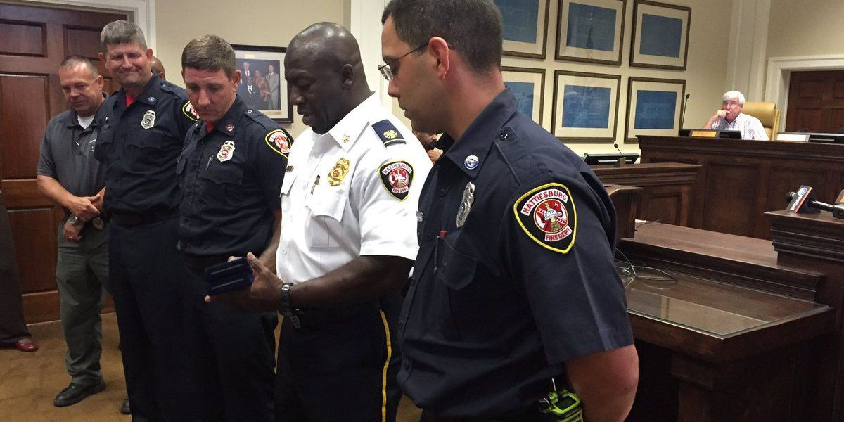 Hattiesburg firefighters awarded for saving woman from burning home