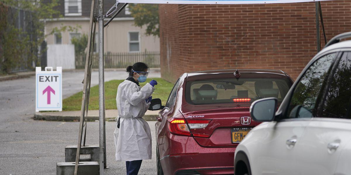 US sets coronavirus infection record; deaths near 224,000
