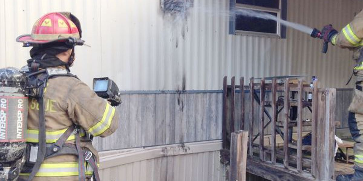 Fire damages mobile home in Powers community